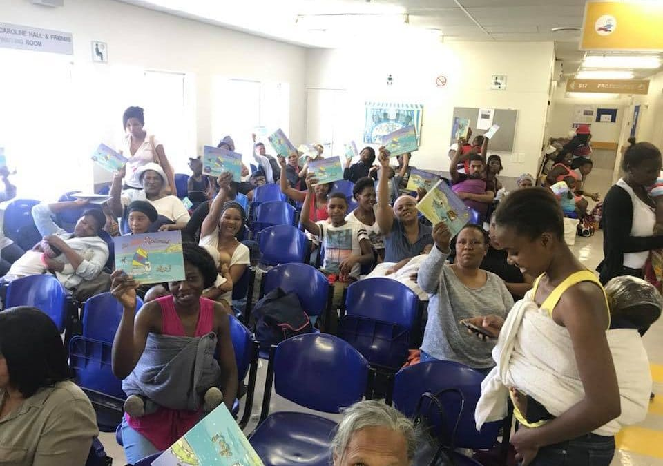 """Kids at the Red Cross Outpatients receive 100s of donated """"The Little Optimist"""" Books 18/12/17"""